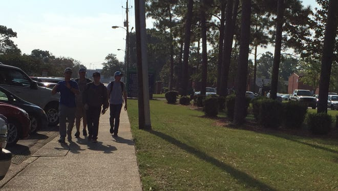 Students walk to class at Pensacola State College on Thursday, Sept. 21, 2017.
