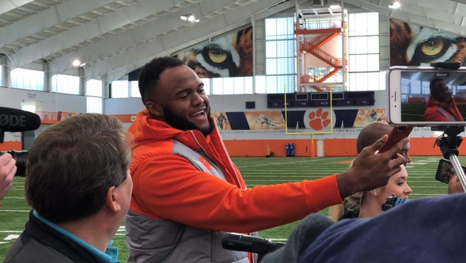 Clemson Tigers defensive end Austin Bryant joins the media scrum during quarterback Kelly Bryant's group interview at Clemson's indoor facility Monday.