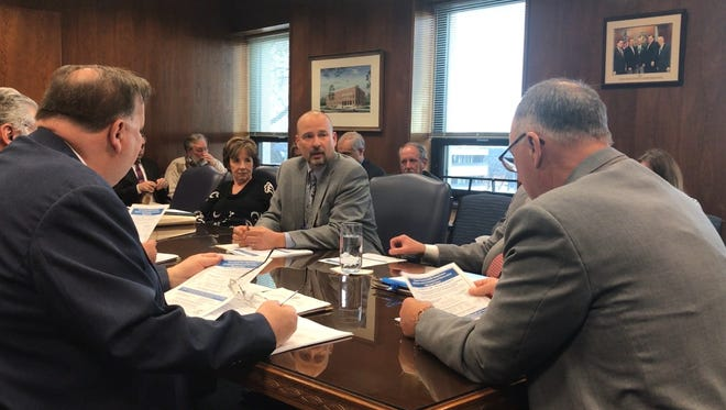 Daniel E. Regenye (center), Ocean County's public health officer, briefs the Board of Freeholders on Wednesday about the dangerous flu outbreak that has killed a 4-year-old girl in Ocean County.