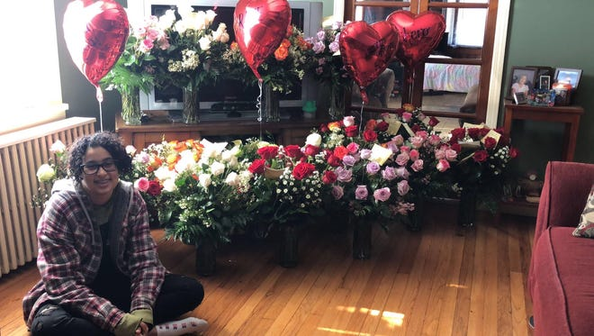 Rosa Rodriguez, the 15-year-old Sayreville High School who walked out of class on Wednesday by herself, sitting next to the roses she has received from supporters.