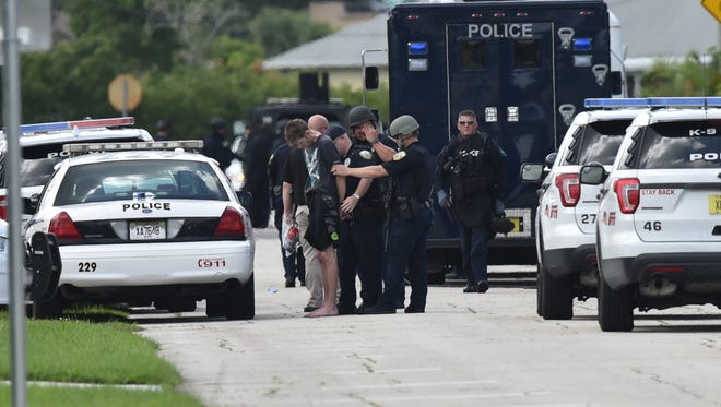 A man is taken into custody after Port St. Lucie police and SWAT team members arrived at a house in the 2100 block of SW Trenton Lane on Friday, June, 1, 2018. Police responded to the home for a domestic violence investigation with a possible barricaded subject inside the residence. Shortly afterward, the suspect surrendered to the SWAT team.