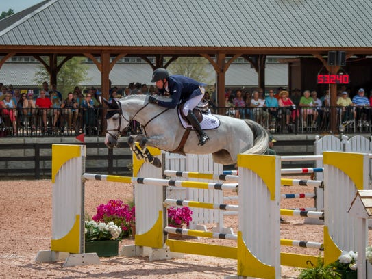 A rider competes in the Grand Prix during the fall