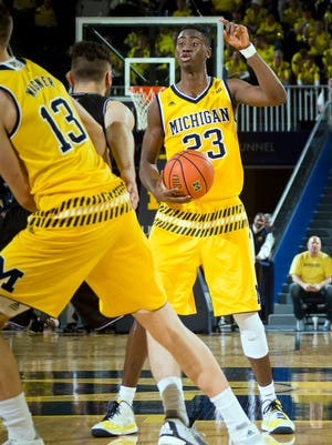 Michigan guard Caris LeVert (23) gestures to his teammates against Bryant at the Crisler Center in Ann Arbor on Dec. 23, 2015.