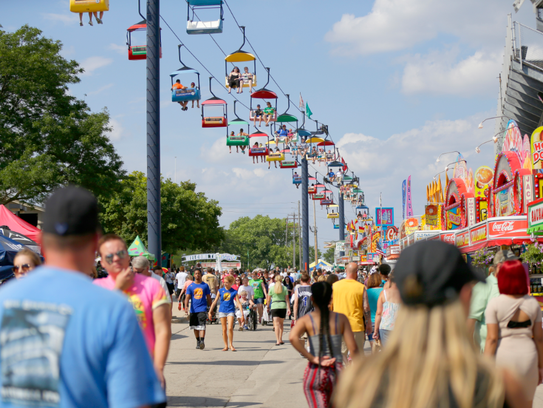 The Sky Glider hovers above Wisconsin State Fair goers.