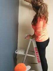 Volunteers apply a fresh coat of paint to FYI visitation rooms.