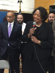Deborah L. Wortham, East Ramapo's new interim superintendent, speaks to the audience at a school board meeting Wednesday. State-appointed monitor Dennis Walcott stands to her left.