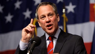 New York Attorney General-elect Eric Schneiderman gestures while giving his victory speech just past midnight Nov. 3, 2010, in New York.