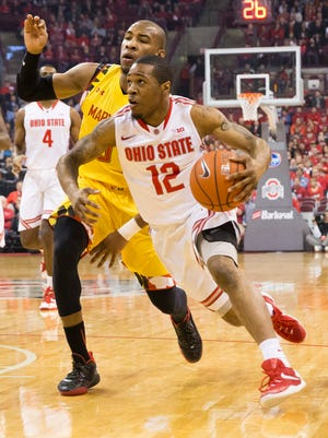 Ohio State Buckeyes guard A.J. Harris (12) dribbles the ball around Maryland Terrapins guard Rasheed Sulaimon (0) at Value City Arena. The Terrapins won 66-61.