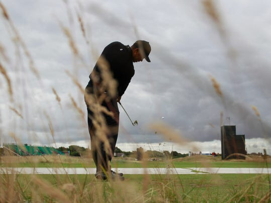 Tiger Woods of the US plays a shot off the 9th tee during a practice round ahead of the British Open Golf championship at the Royal Liverpool golf club, Hoylake, England, Tuesday July 15, 2014. The British Open starts on Thursday July 17. (AP Photo/Peter Morrison)