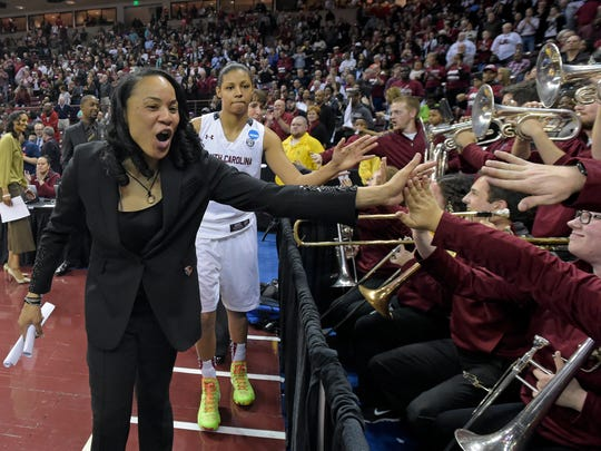 South Carolina head coach Dawn Staley high fives the South Carolina band after the Gamecocks 81-48 1st round NCAA Tournament win over Savannah State Friday, March 20, 2015 at Carolina's Colonial Life Arena.