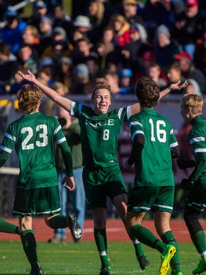 Rice Memorial's Louis Gazo celebrates his first-half goal against CVU in the Division I boys soccer championship in Burlington on Saturday, October 31, 2015.