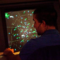 An air traffic controller works in a control room at the Atlanta TRACON in Peachtree City, Ga.