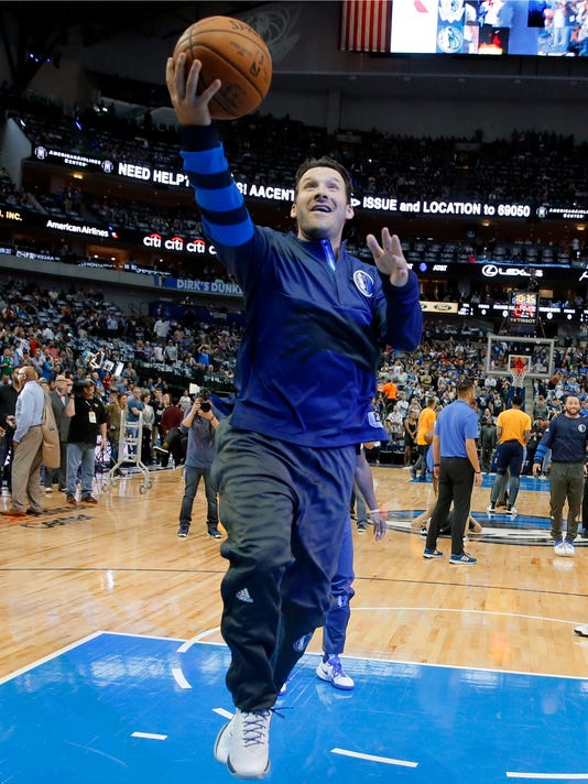 Former Dallas Cowboys quarterback Tony Romo goes up for a shot during warm ups before an NBA basketball game between the Denver Nuggets and Dallas Mavericks in Dallas, Tuesday, April 11, 2017. (AP Photo/Tony Gutierrez)
