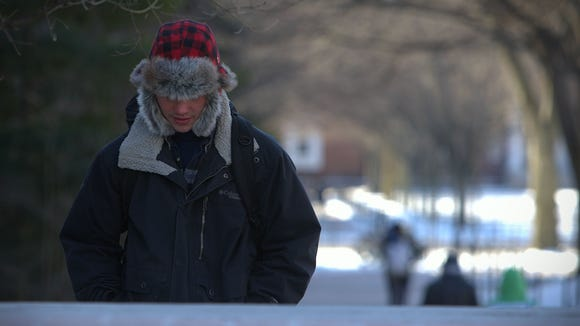Students on the UD campus bundle up as they head to class with the temperature of 5 degrees and a wind chill of negative 17 in Newark.
