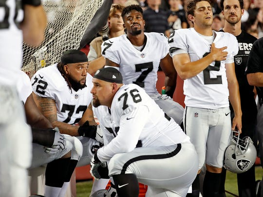 Some members of the Oakland Raiders sat on the bench