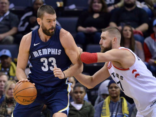 The Grizzlies sent center Marc Gasol (33) to the Raptors in exchange for center Jonas Valanciunas, right, as part of a trade last week.