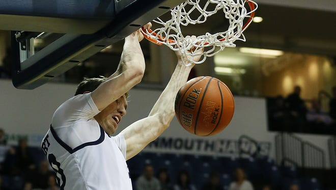 Monmouth Hawks guard Collin Stewart (30) scores with a dunk against Marist Red Foxes during second half  at Ocean First Bank Center, Monmouth University. Monmouth Hawks defeated Marist Red Foxes 71-64. West Long Branch,NJ.  Sunday, January 8, 2017.   Noah K. Murray-Correspondent/Asbury Park Press ASB 0109 Monmouth Basketball