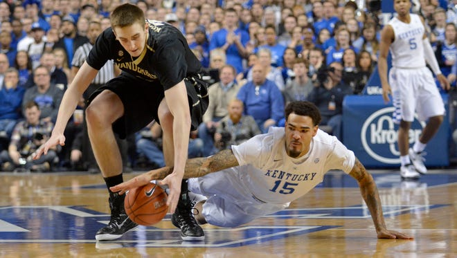 Kentucky's Willie Cauley-Stein fights for a loose ball with Vanderbilt's Luke Kornet during the first half at Rupp Arena in Lexington Tuesday Night.
