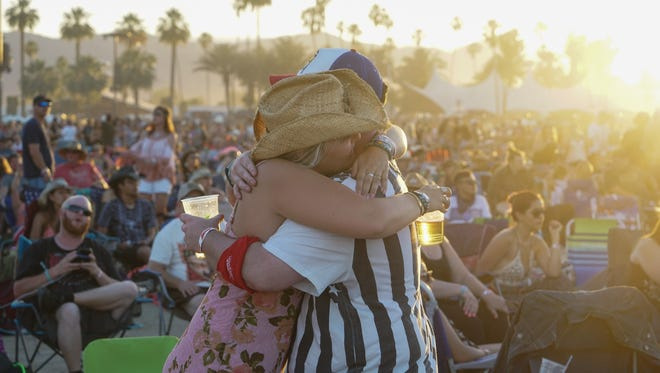 Apr 30, 2017; Indio, CA, USA; Festival goers embrace while Tyler Farr performs during the Stagecoach Country Music Festival at Empire Polo Club. Mandatory Credit: Zoe Meyers/The Desert Sun via USA TODAY NETWORK