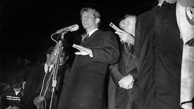 Robert F. Kennedy tells a gathering in Indianapolis on April 4, 1968, that Martin Luther King Jr. is dead.