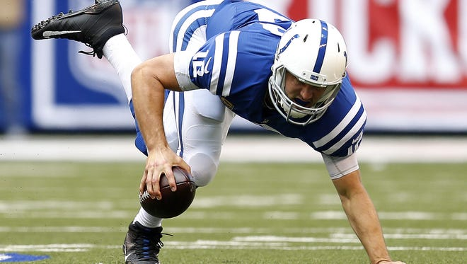 Indianapolis Colts quarterback Andrew Luck (12) is tripped up behind the line against the Detroit Lions at Lucas Oil Stadium on Sept. 11, 2016.