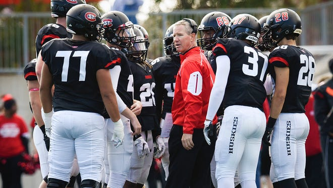St. Cloud State head coach Scott Underwood talks with players during a time out against the University of Mary during the first half Saturday, Oct. 8, at Husky Field.