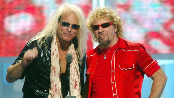 David Lee Roth, left, and Sammy Hagar address the audience at the 2002 MTV Video Music Awards.
