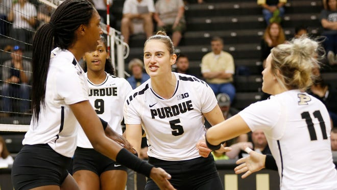 Purdue's Ashley Evans (5) and her teammates celebrate a point against Oral Roberts in the second set Friday, August 25, 2017, at Holloway Gymnasium on the campus of Purdue University. Purdue defeated Oral Roberts 25-15, 25-13, 25-20.