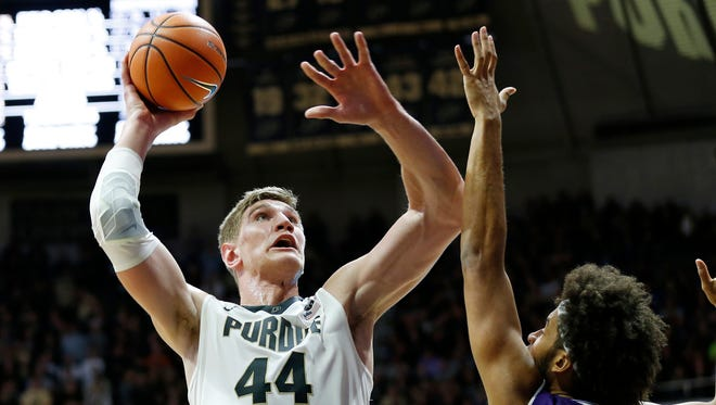 Isaac Haas of Purdue with a shot over Barret Benson of Northwestern in the first half Sunday, December 3, 2017, at Mackey Arena.