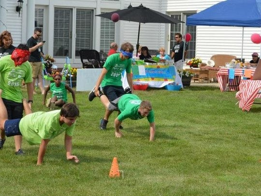 Blindfolded wheelbarrow races were among the competitive events at the fifth annual Julianna and Max's Field Day for Charity.