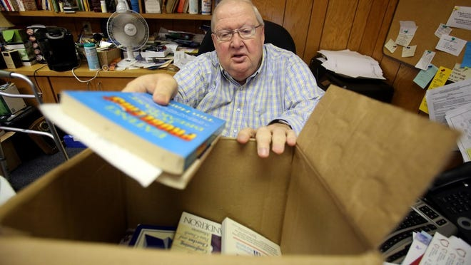 Charles Reed packs up books to be donated around the world before retiring from the Greater Cleveland County Baptist Association in 2017.