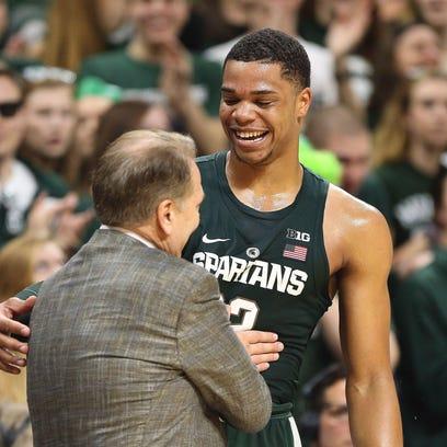 Michigan State coach Tom Izzo jokes with Miles Bridges