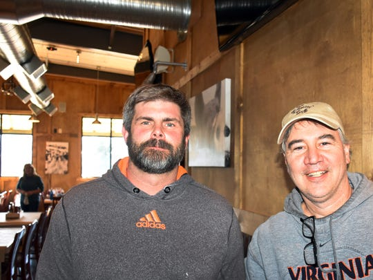 Leighton Justice, left, and Perry Fridley of Waynesboro are two of the owners of the new location of the Fishin' Pig, set to open this week.