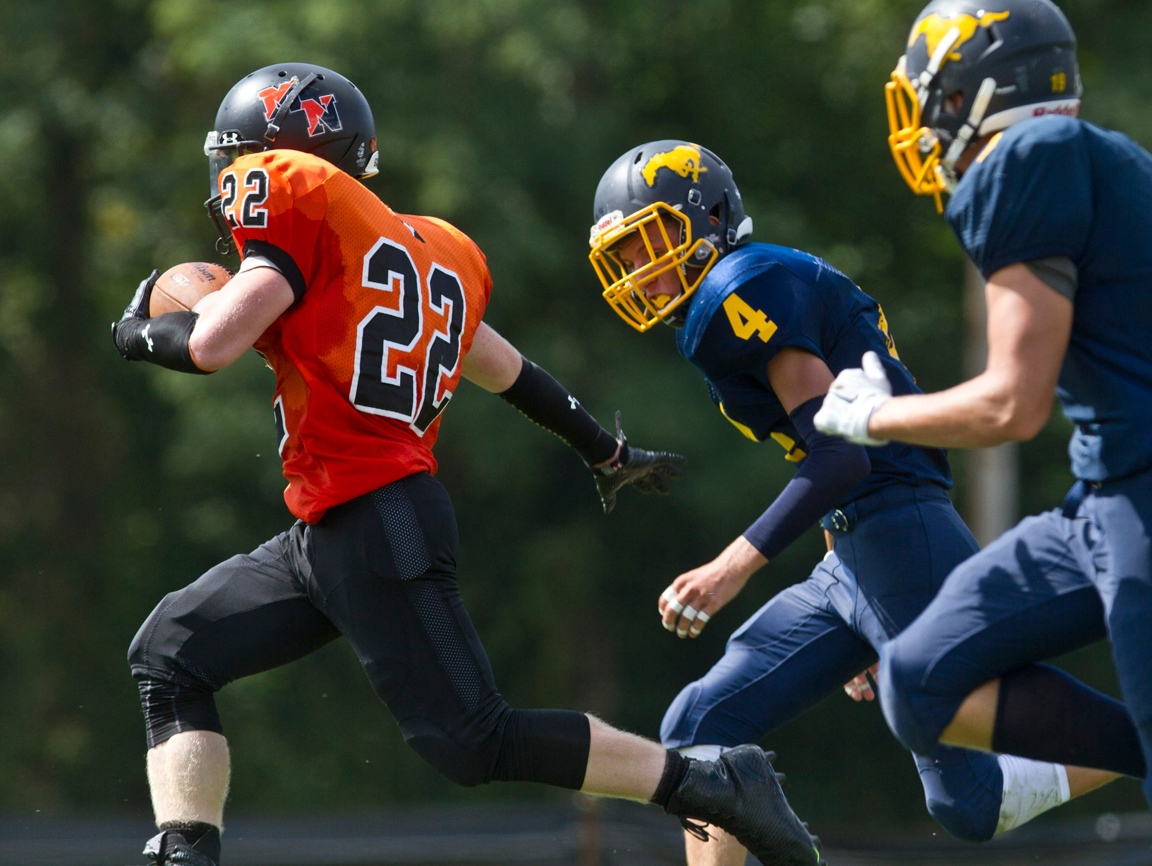 Middletown North's Connor Welsh takes off for the end zone . Middletown North vs Marlboro football. Marlboro, NJ Saturday, September 19, 2015 @dhoodhood