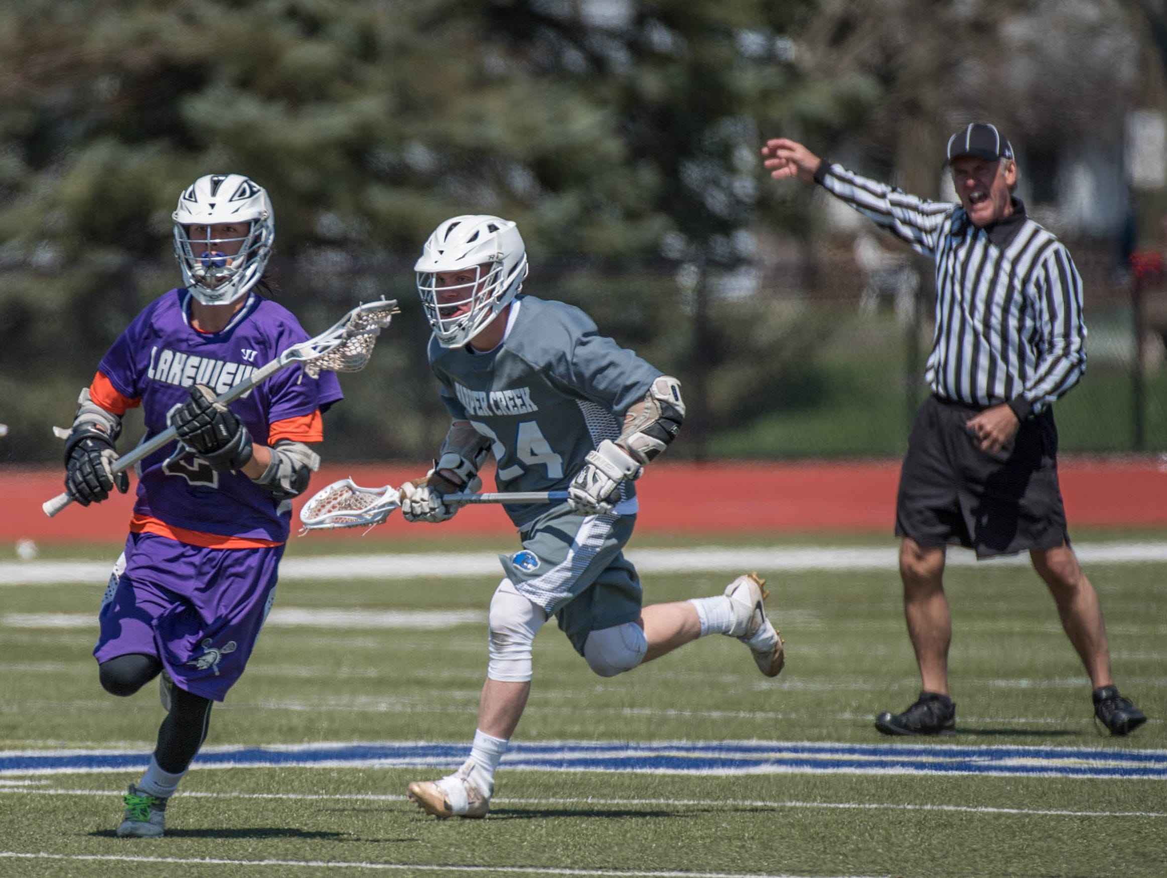 Lakeview's Jayson Butler (2) advances the ball against Harper Creek in the All City Lacrosse Tournament on Saturday.