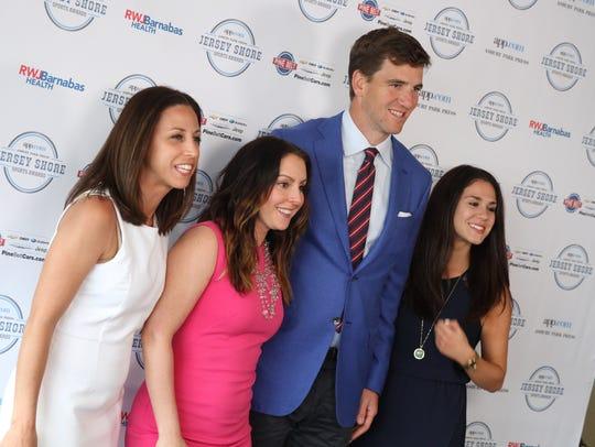 People take a photo with NY Giants quarterback Eli