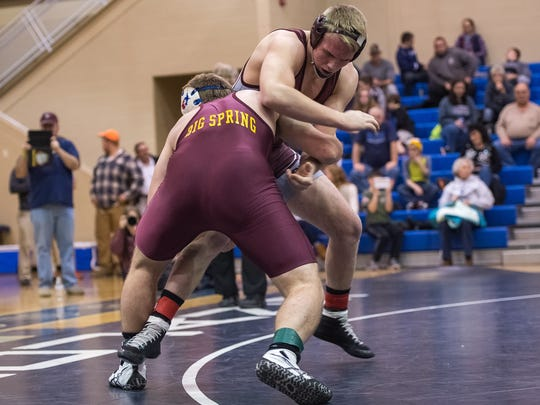 Cole Forrester of Shippensburg, right, tangles with Big Spring's Blake Barrick in the Trojans Wars final at 195. Barrick won 6-4 in overtime. Forrester is seeded No. 3 and Barrick No. 2 for Saturday's sectionals.