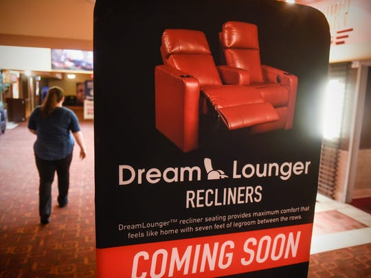 A sign announces the opening of more theatres with DreamLounger recliner seating Wednesday, April 18, at Marcus Parkwood Cinema in Waite Park.