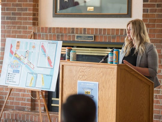 Downtown Development Authority director Natalie Watson speaks about Blue Water Fest at the Bell's Beer Bayview Mackinac Race conference Wednesday, June 13, 2018, at the Port Huron Yacht Club. During this year's fest, attendants can expect a carnival at Kiefer Park, food trucks, fireworks, a silent disco and other entertainment.