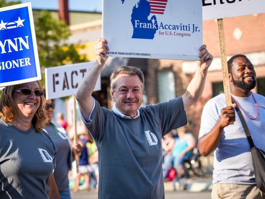 Macomb County Democrat Frank Accavitti walks with the