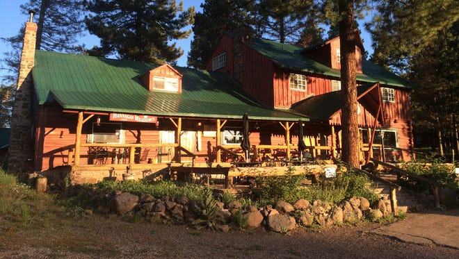 The rustic Hannagan Meadow Lodge, established in 1926, basks in the glow of sunrise. Summer visitors are drawn to the comfortable temperatures experienced at 9,100 feet.