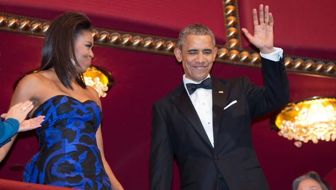 President Obama, with first lady Michelle Obama, waves as he arrives at the 2015 Kennedy Center Honors in Washington Sunday after making an address to the nation.