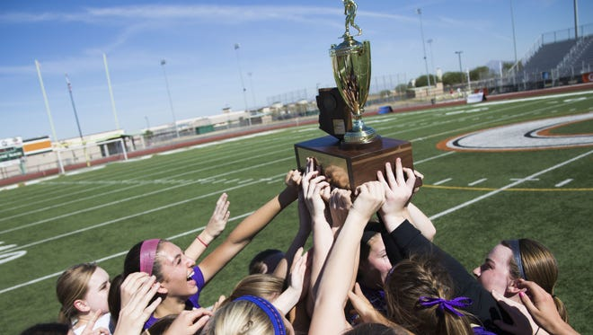 Notre Dame Prep raises the Division II State Championship trophy after beating Salpointe Catholic at Campo Verde High School in Gilbert, Ariz., on Saturday, February 13, 2016.