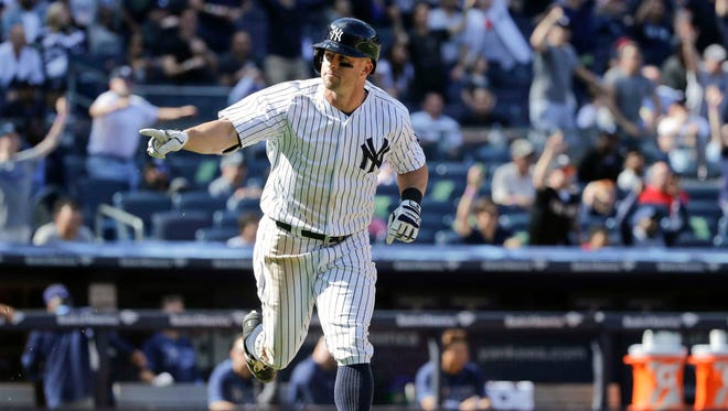 Brett Gardner points to his dugout as he runs the bases after hitting a walk-off home run during the ninth inning against the Tampa Bay Rays Saturday, April 23, 2016.