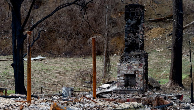 A chimney remains of a building burned down by the wildfires along Baskin's Creek Road 90 days after the Gatlinburg wildfires in Gatlinburg on Wednesday, March 1, 2017.