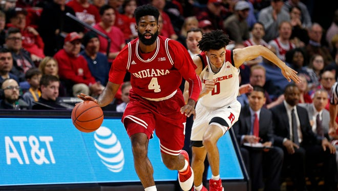 Indiana guard Robert Johnson (4) brings the ball upcourt in front of Rutgers guard Geo Baker (0) during the first half of an NCAA college basketball game Monday, Feb. 5, 2018, in Piscataway, N.J.