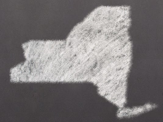 Blackboard with the shape of New York drawn onto.