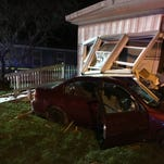 Car crashes into mobile home in Highland Township