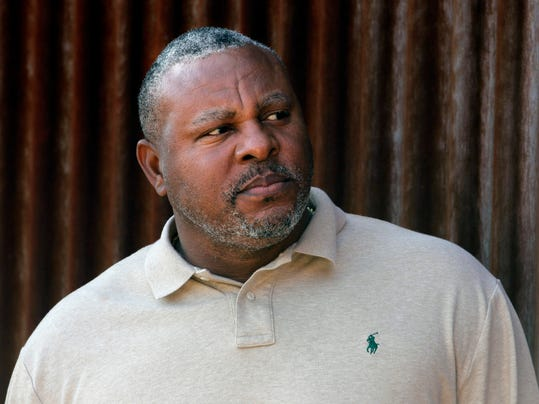 FILE - In this Tuesday, Feb. 28, 2012, file photo, former baseball player Albert Belle looks on as he visits the Cleveland Indians' spring training camp in Goodyear, Ariz. Belle has been arrested on indecent exposure and extreme driving under the influence charges following a spring training game in Arizona. Belle was taken into custody in Scottsdale, Arizona, on Sunday, March 25, 2018. (AP Photo/Jae C. Hong,File)
