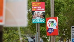 Posters for and against same-sex marriage are seen